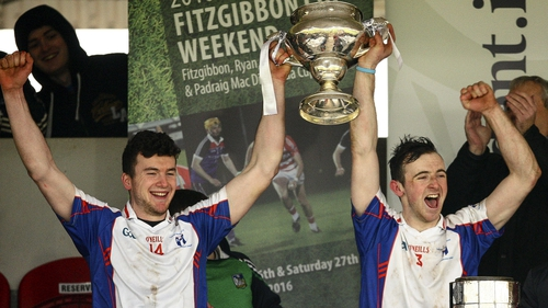 Mary Immaculate's Declan Hannon and captain Richie English hoist the Fitzgibbon Cup
