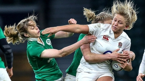 England's Ceri Large is tackled by Ireland's Mairead Coyne