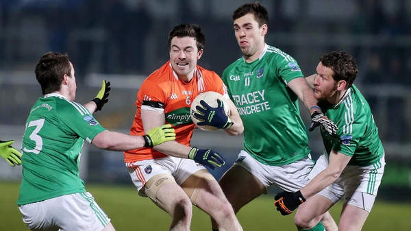Armagh's Aidan Forker is well marshalled by Fermanagh's Che Cullen, Ryan Jones and Niall Cassidy