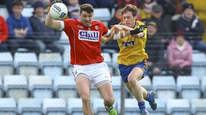 Cork's Tomas Clancy under pressure from Roscommon's Conor Devaney at Pairc Ui Rinn