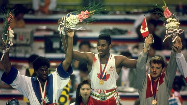 Lennox Lewis (C) won gold for Canada at the 1988 Olympics