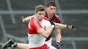 Derry's Niall Holly gets away from Galway's Thomas Flynn at Celtic Park