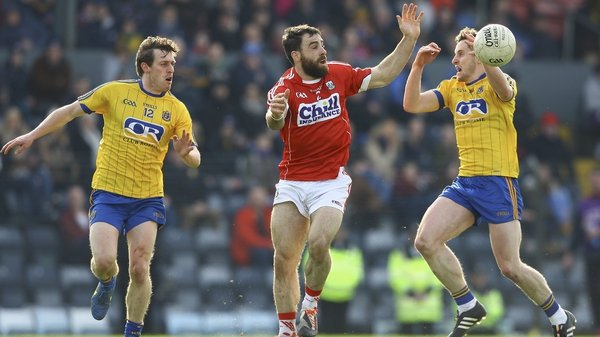 Cork's Colm O'Driscoll with Roscommon's Conor Devaney and double-goalscorer Ciaran Murtagh (R)