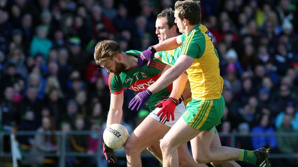 Mayo's Aidan O'Shea is well marshalled by Donegal duo Michael Murphy and Hugh McFadden