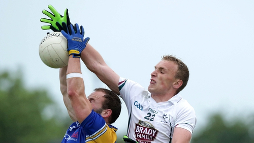 Kildare goalscorer Tommy Moolick jumps for a ball against Longford