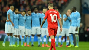 Liverpool's Brazilian midfielder Philippe Coutinho completes the walk of shame after his tame penalty was saved by City keeper Willy Caballero