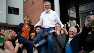 Sinn Féin's Gerry Adams and Sinn Féin Cllr Imelda Munster are held aloft outside the count centre in Dundalk after being elected in Louth