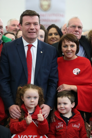 Labour's Alan Kelly with his wife Regina and children Aoibhe (left) and Senan during the count in Thurles, Tipperary