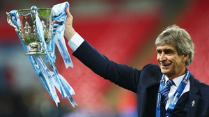 Manuel Pellegrini shows off Manchester City's newest piece of silverware