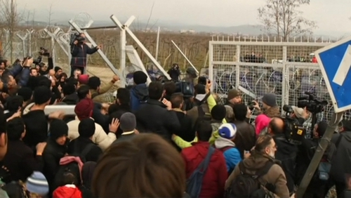 Refugees tried to break through the border fence