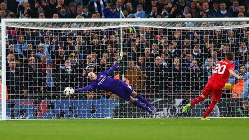 Willy Caballero saves Adam Lallana's penalty during the Capital One Cup Final shootout
