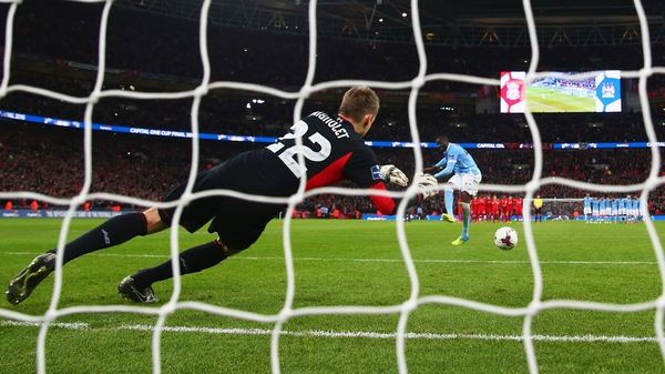 Simon Mignolet is beaten by a Yaya Toure penalty in the 2016 League Cup final
