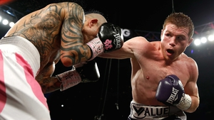Saul Alvarez (R) lands a blow during his victory over Miguel Cotto
