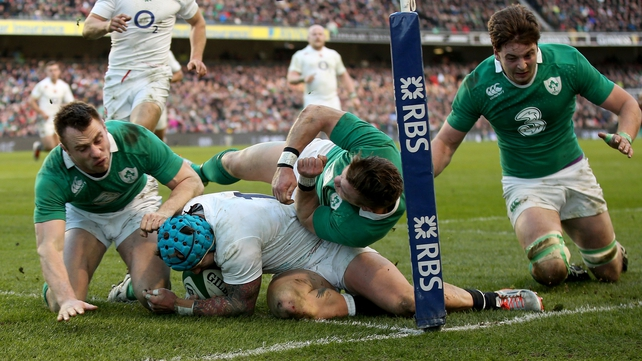 Tommy Bowe (L) and Iain Henderson (R) in action for Ireland last year