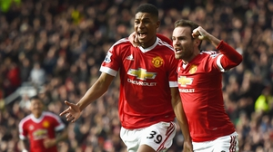 Marcus Rashford of Manchester United celebrates scoring his opening goal with Juan Mata (R)