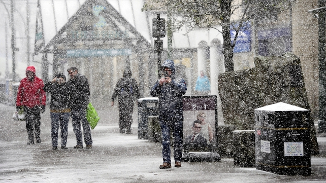 People makes their way through Buxton, Derbyshire as Storm Jake hits the UK