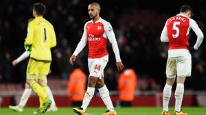 Theo Walcott cuts a disconsolate figure after the loss to Swansea