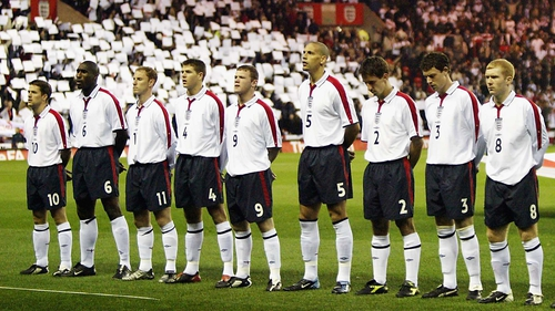 The England soccer team line up for the anthem in 2003