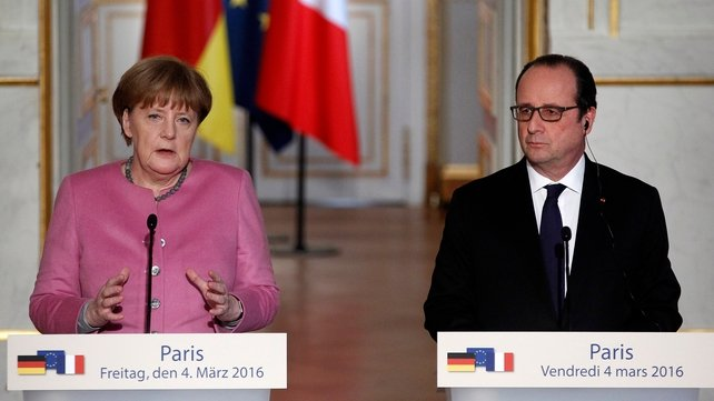 German Chancellor Angela Merkel and French President Francois Hollande speaking at a press conference in Paris