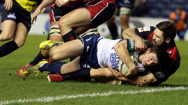 Connacht's AJ MacGinty scores a try despite being tackled by Cornell Du Preez of Edinburgh