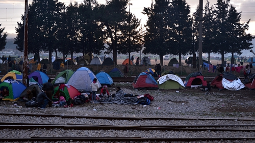 Migrants in tents at a makeshift camp on the Greek border with Macedonia