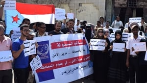 Yemenis gather outside Aden's security department to protest against the care home attack