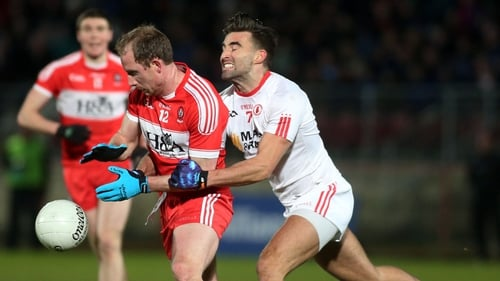 Derry's Sean Leo McGoldrick and Tienan McCann of Tyrone battle for possession at Healy Park
