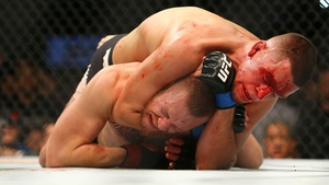 Nate Diaz applies the winning choke-hold to Conor McGregor