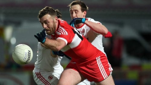 Derry's Emmett McGuckin and Tyrone's Colm Cavanagh scrap for possession