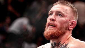 McGregor bid to become the first athlete ever to hold two UFC titles at the same time at UFC 205