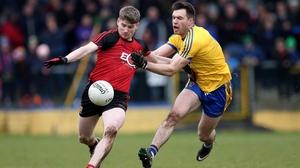 Ian Kilkbride and Conor Maginn battle for possession