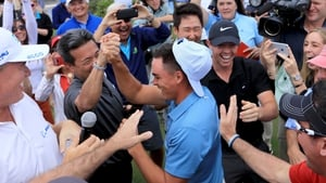 Rickie Fowler is mobbed at the Old Palm Golf Club