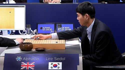 Lee Se-Dol plays his first stone against Google's artificial intelligence program, AlphaGo