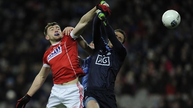 Cork's Peter Kelleher rises with goalkeeper Michael Savage of Dublin