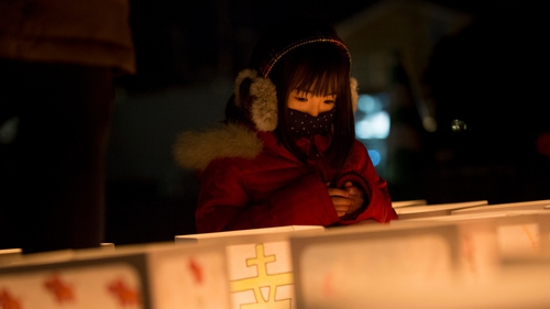 A girl looks at paper lanterns at Natori City Office to mark the fifth anniversary of the earthquake and tsunami which claimed the lives of 15,894