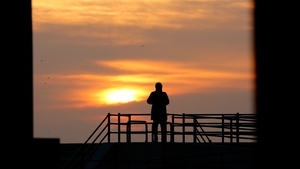 A man stands alone on a coastal levee in the coastal district of Sendai