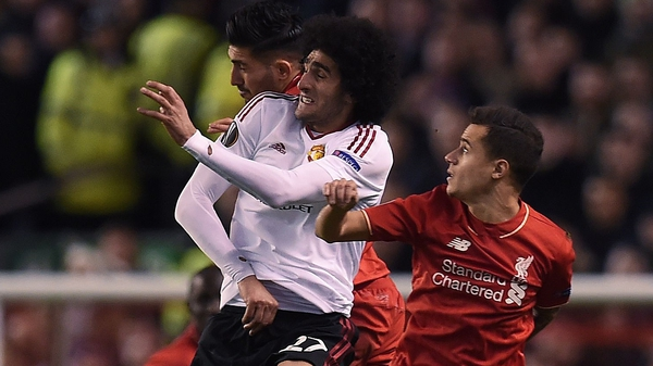 Emer Can and Marouane Fellaini had a running battle at Anfield