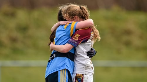 Nicola Ward (left) hugs her twin sister Louise after the O'Connor Cup final