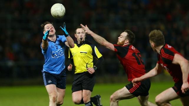 Down's Ryan Mallon with Dublin's Philly McMahon