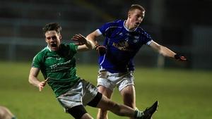 Fermanagh's Tomas Corrigan Jason McLoughlin of Cavan battle for possession at Brewster Park