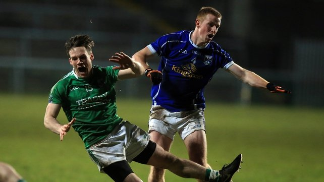 Fermanagh's Tomas Corrigan Jason McLoughlin of Cavan battle for possession at Brewster Park