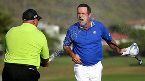 Scott Hend is sprayed with champagne after winning in Thailand