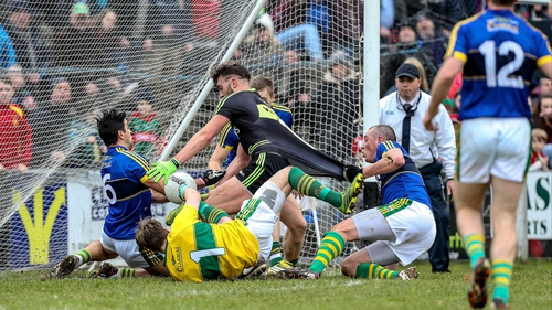 Mayo's Aidan O'Shea is held back on the goal line by Kieran Donaghy of Kerry