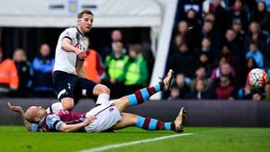 The masked avenger Harry Kane struck twice as Tottenham closed the gap with Leicester