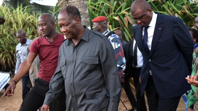 Ivorian president Alassane Ouattara (centre) and Interior Minister Ahmed Bakayoko (right) visit the beach resort