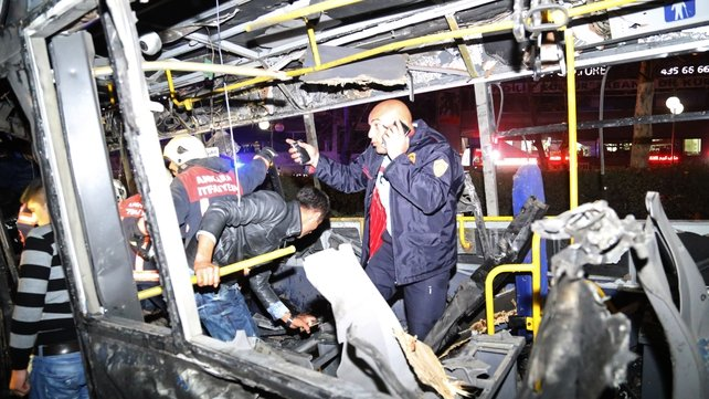 Emergency workers on a bus at the explosion site in Ankara