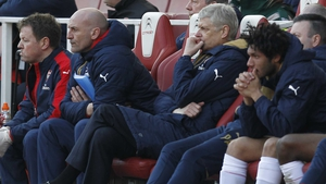A glum-looking Arsenal bench during yesterday's defeat to Watford