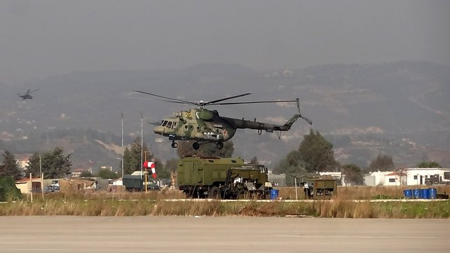 A military helicopter is seen at the Russian Hmeimim military base in Latakia province