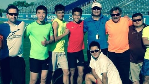John Coghlan (far left) with members of the Chinese sprint team and other coaches