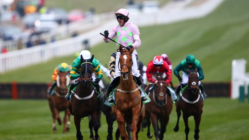 Ruby Walsh celebrates after riding Annie Power to victory and in the process break the track record in the hurdling highlight